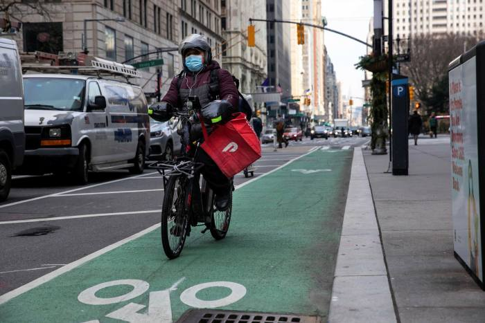 A DoorDash bicycle courier during a delivery in New York