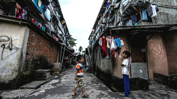 Children in a slum area in Palembang, Indonesia, where poverty has increased because of Covid-19