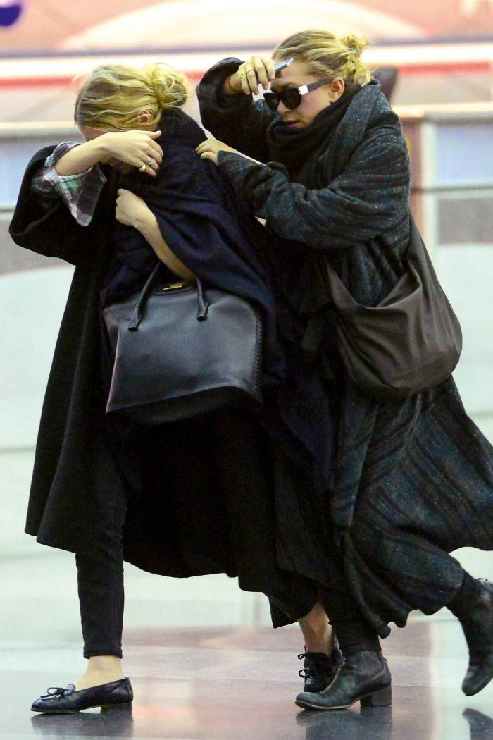 Mary-Kate and Ashley Olsen arriving at LAX in 2014