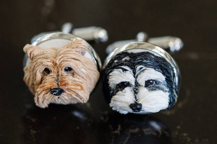 His cufflinks of his two dogs, Winston and Clementine