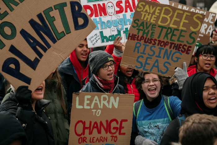 Environmental campaigners from the Sunrise Movement and other groups protest in New York. The movement backed Joe Biden in the presidential election because of his green plans