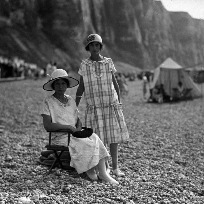Étretat has long been a favourite of fashionable French society, from this Parisian mother and daughter seen here in 1920...