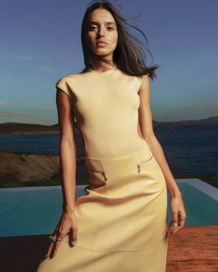 Hermès stretch-silk knit bodysuit, £1,800, and lambskin skirt, £5,000. Chloé vintage gold copper and brass ring, £340. Alighieri sterling silver ring, £210