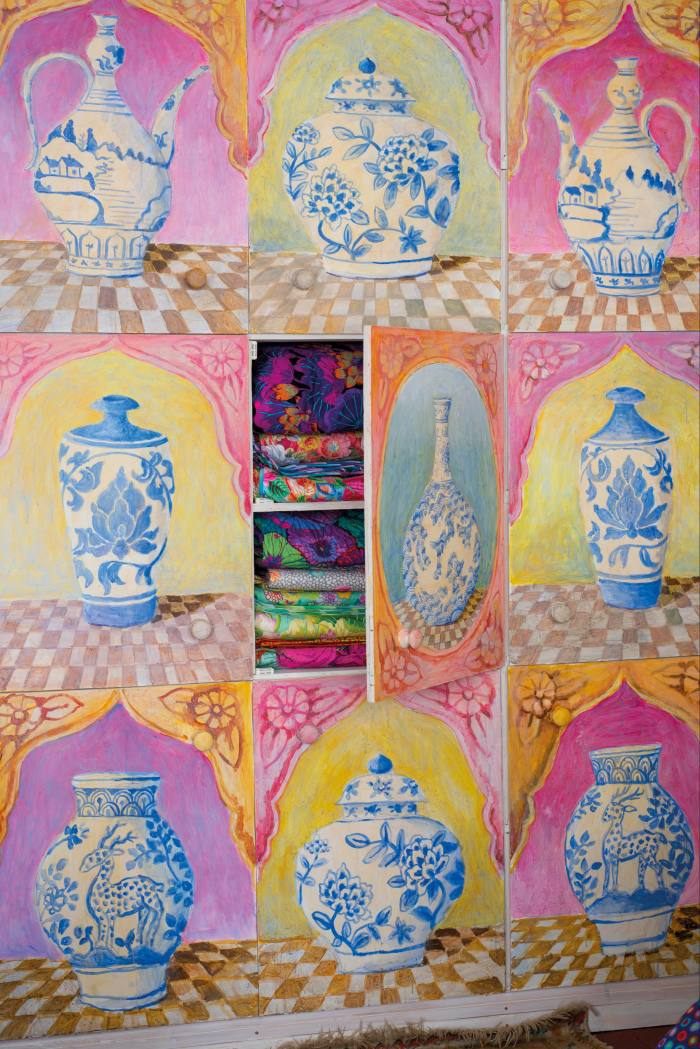 Painted cupboards in textile-designer Kaffe Fassett's living room