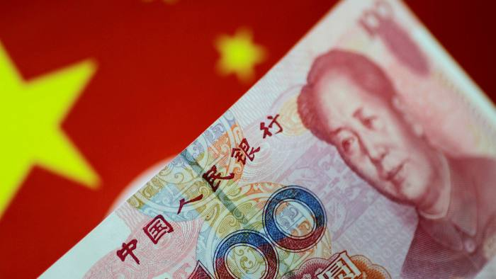 A Chinese flag and a renminbi note
