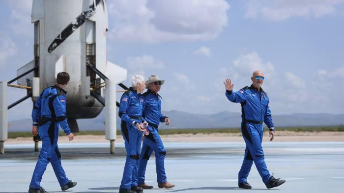 Amazon founder Jeff Bezos with his Blue Origin crew and passengers