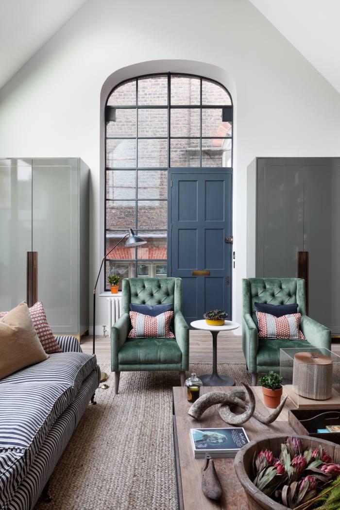 Crittall-style windows flood this South Kensington mews house with light