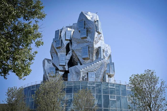 A twisting tower clad in reflective aluminium tiles, designed by US architect Frank Gehry, and housing Luma Foundation is pictured on July 1, 2019 in Arles, southern France