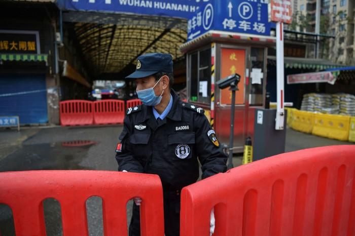 A barricaded Huanan wholesale market in Wuhan