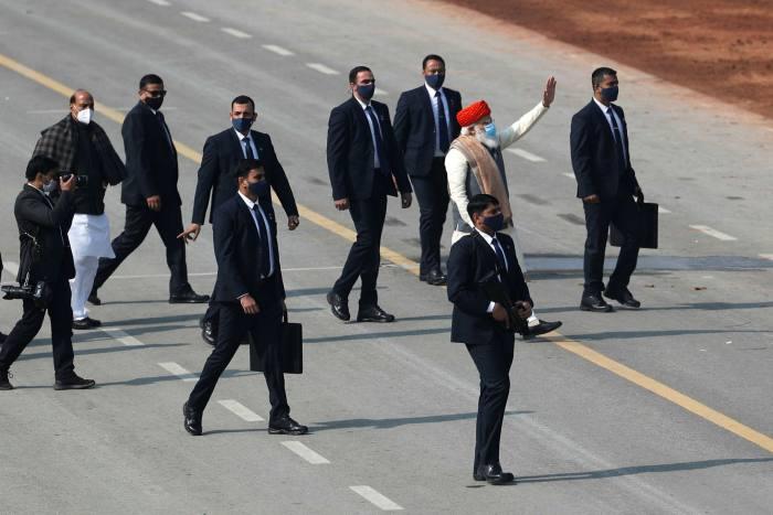 Narendra Modi, in red hat, celebrating India's Republic Day on January 26