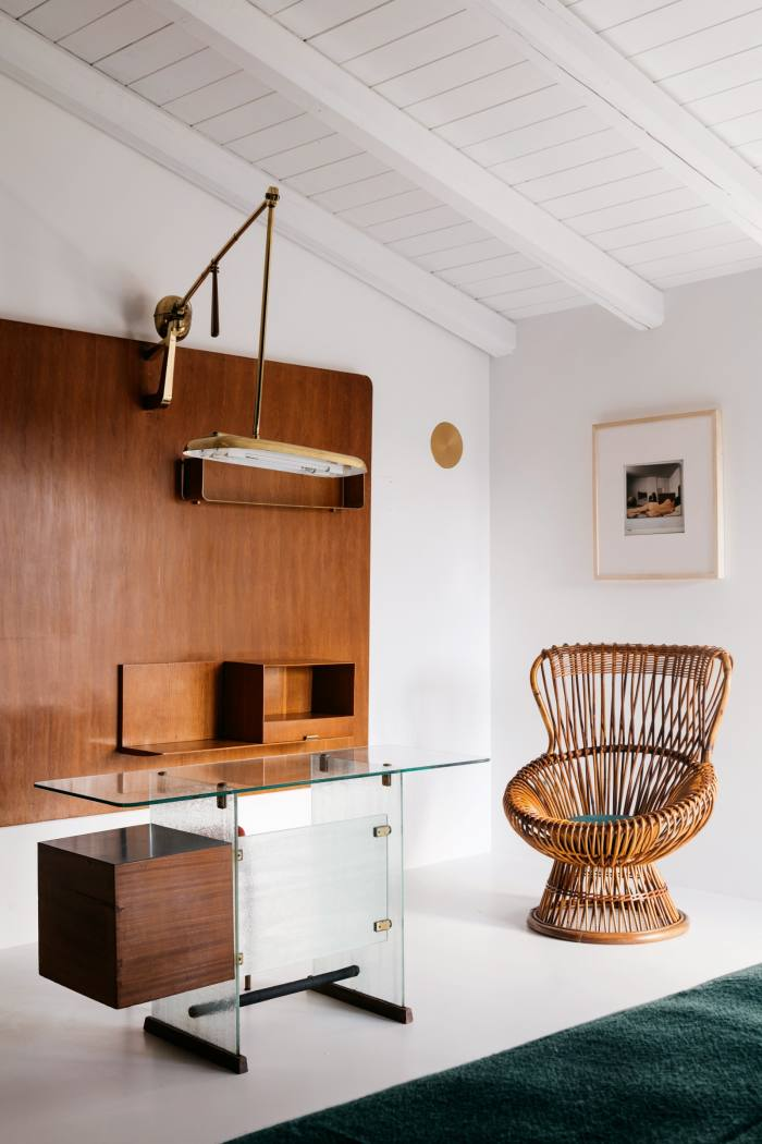 In one room a 1939 Gio Ponti desk and 1946 shelving unitare juxtaposed with a 1970 print by Italian photographer Ugo Mulas and a 1950s-'60s Franco Albini cane chair