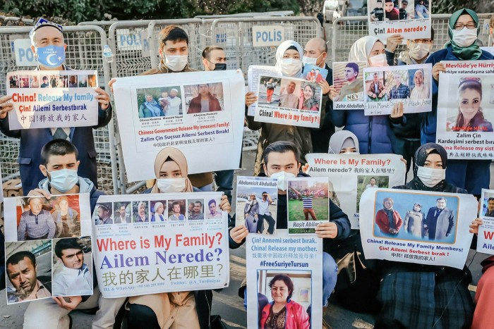 Members of the Muslim Uighur minority protest outside the Chinese consulate last December in Istanbul