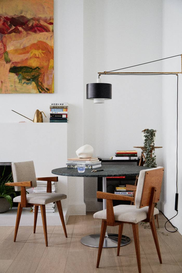 Yokoyama's marble-topped table by stonemason James Elliott, with its 1960s Pierre Cardin base. The painting on the wall is by Antonia Showering, and a Carl Auböck watering can sits on the mantelpiece