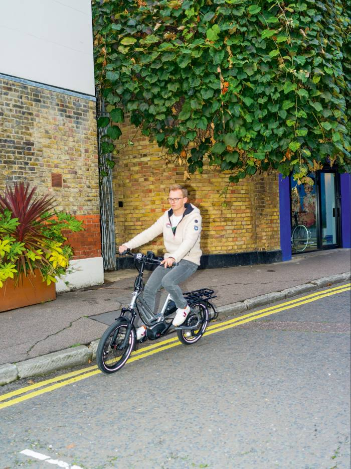 the author on a Tern HSD S+, £5,300, from fullycharged.com. He wears Café du Cycliste fleece Ondine top, £176, and APC denim Petit Standard jeans, £175, from matchesfashion.com