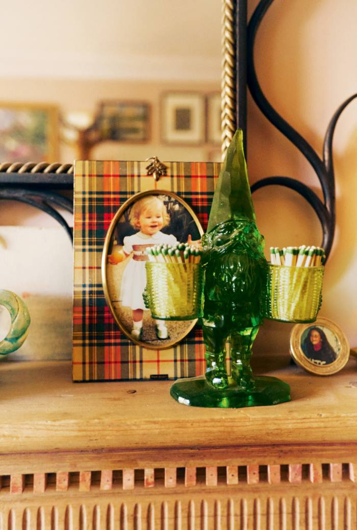 A green resin gnome and aphotograph of Margot