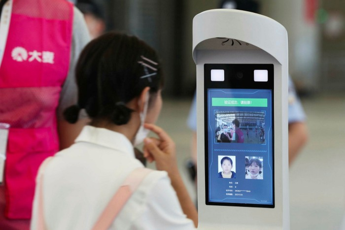 Delegates are scanned by facial-recognition devices as they enter the China Digital Entertainment Expo & Conference last July in Shanghai