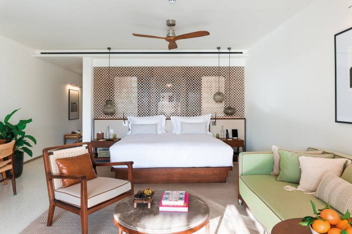 Rooms are decorated with a traditional finca aesthetic