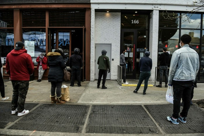Customers waiting outside a restaurant for takeaway orders in Brooklyn, New York, on April 15