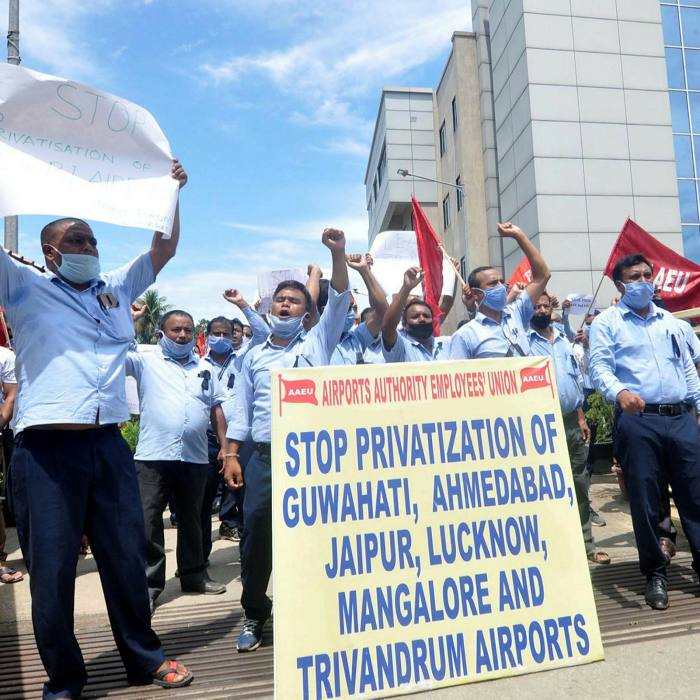 Members of Airport Authority Employees Union protest over the approval to lease three airports under the public-private partnership model, outside LGBI Airport in Guwahati