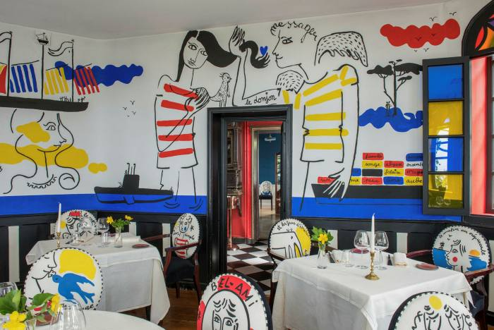 Frescoes by fashion designer Jean-Charles de Castelbajac cover the walls at Michelin-starred Le Donjon – Domaine Saint Clair