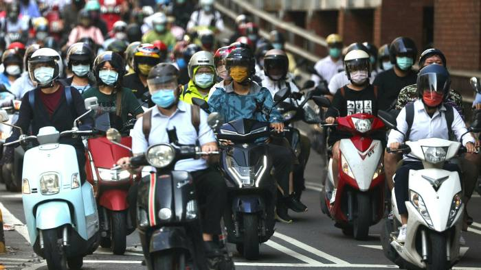 Commuters wear face masks to protect themselves from the coronavirus disease in Taipei, Taiwan
