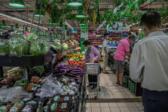 Customers shop at a supermarket in Beijing. The shopping spree by the rich will not offset the spending cuts by the rest of the population