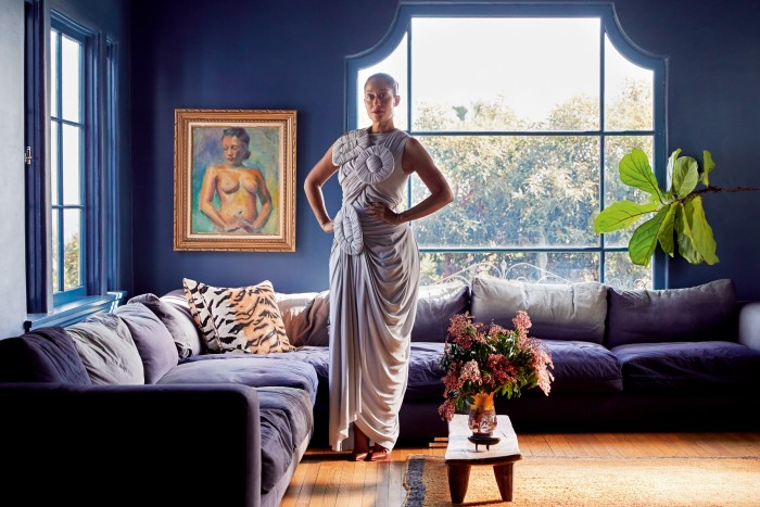 Ross at home in Los Angeles, wearing a Loewe dress and Christian Louboutin shoes