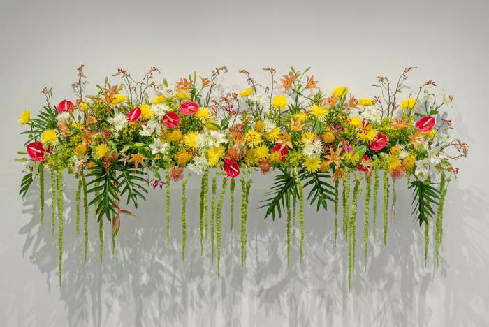 A long arrangement of yellow and red flowers