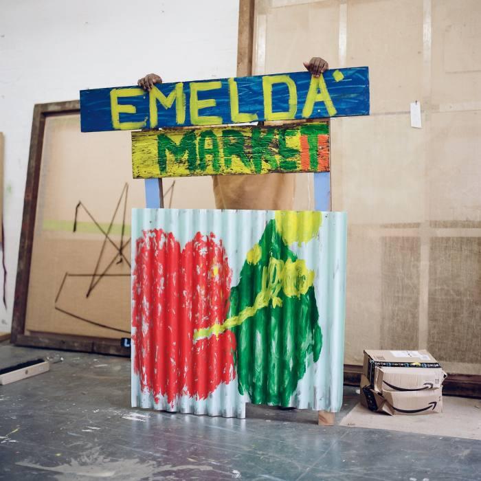 "Barrington with his piece ""Emelda's Market"""