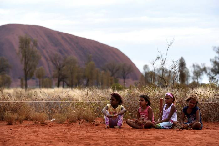 Aboriginal children near Uluru: secondments allow cadet lawyers to stay closer to their roots