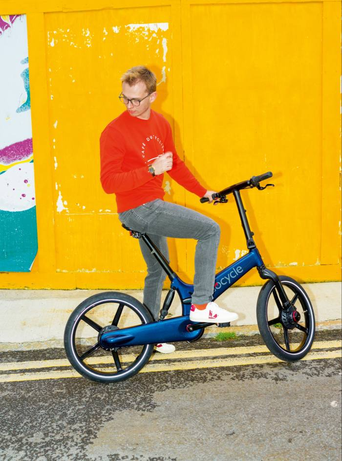 The author on a Gocycle GX, £2,899. He wears Café du Cycliste cotton Clementine sweatshirt, £83, and APC denim Petit Standard jeans, £175, from matchesfashion.com