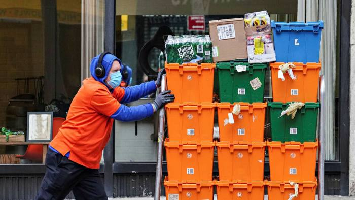 Taking the strain: a worker for FreshDirect, a US online grocery delivery service. Some 22m Americans bought their groceries online for the first time last year