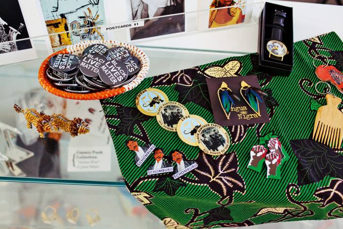 Lapel pins, $10-$15, Lingua Nigra earrings, $124, and Cyril Innis watch, $40