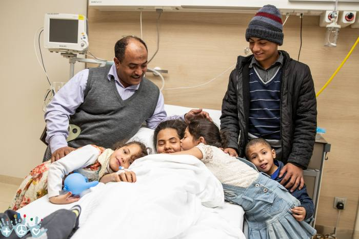 A refugee family from Yemen whose eldest daughter has just had surgery provided through COWF