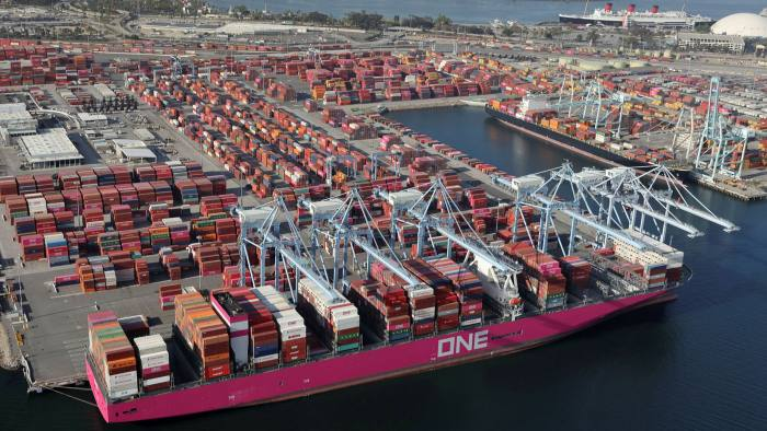 Shipping containers are unloaded from ships at a container terminal at the Port of Long Beach-Port of Los Angeles complex