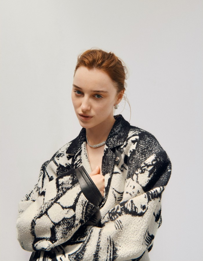 Louis Vuitton cotton/viscose coat, €4,800,and white-gold and diamond L'Elan Vital necklace and earrings