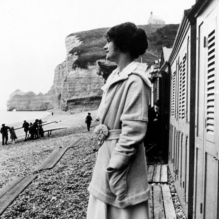 ...to Gabrielle 'Coco' Chanel, photographed on the beach in 1912