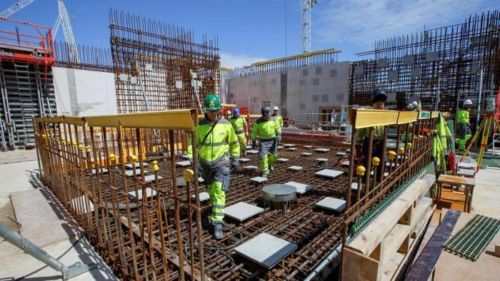 Contractors work on EDF's Hinkley Point C