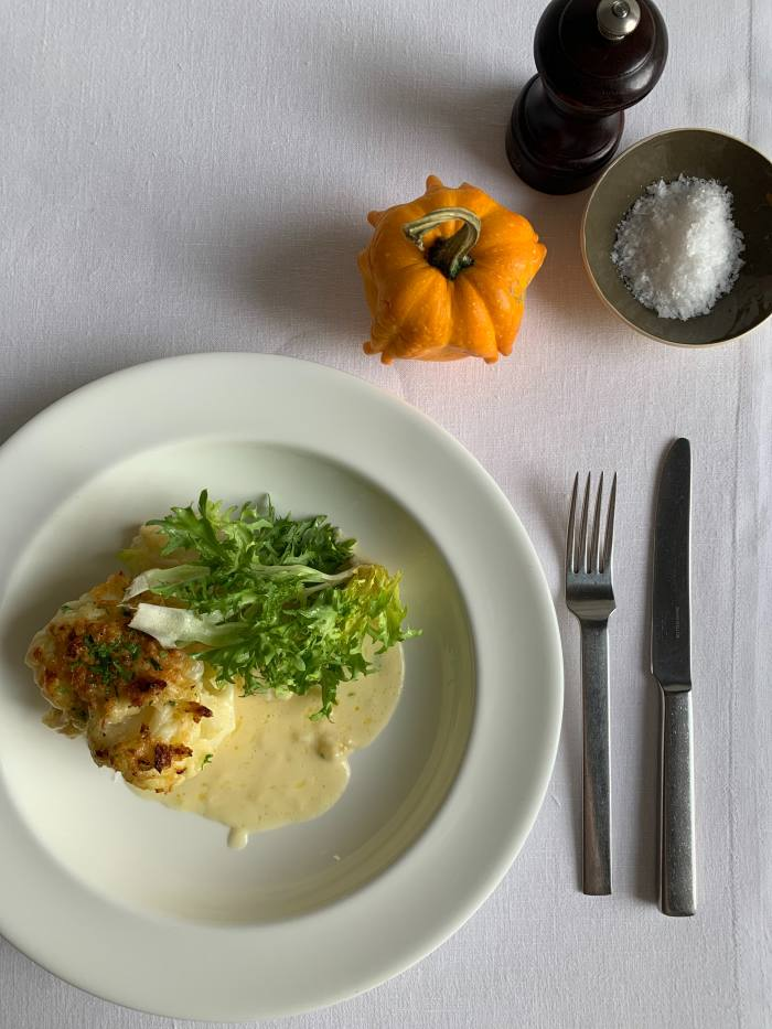 Gratin of cauliflower with Lincolnshire Poacher by Skye Gingell, whose signature dishes can be delivered within a 12km of her Spring restaurant in Somerset House