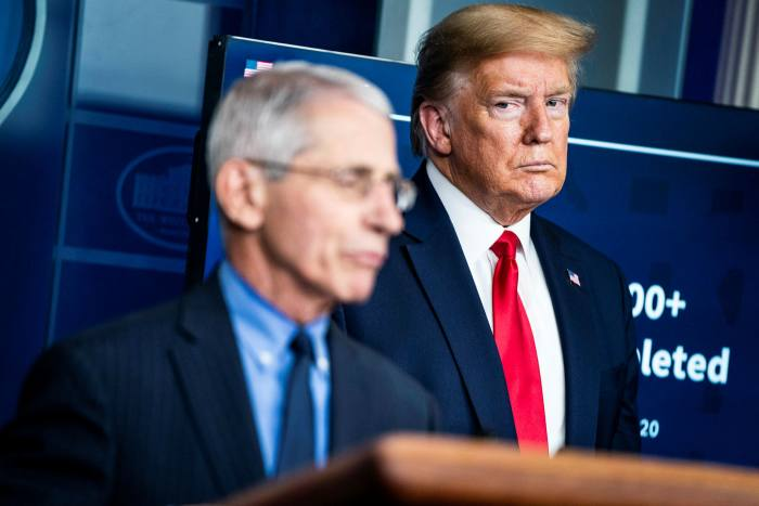 Fauci with Donald Trump at the White House in April. He says he has not seen the president in person since early June