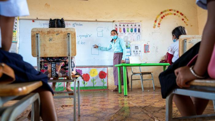 A teacher at the village primary school of Trom, in Cambodia, during the pandemic