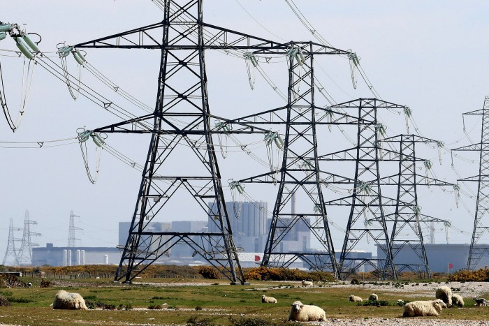 Pylons carry electricity away from Dungeness nuclear power station in Kent