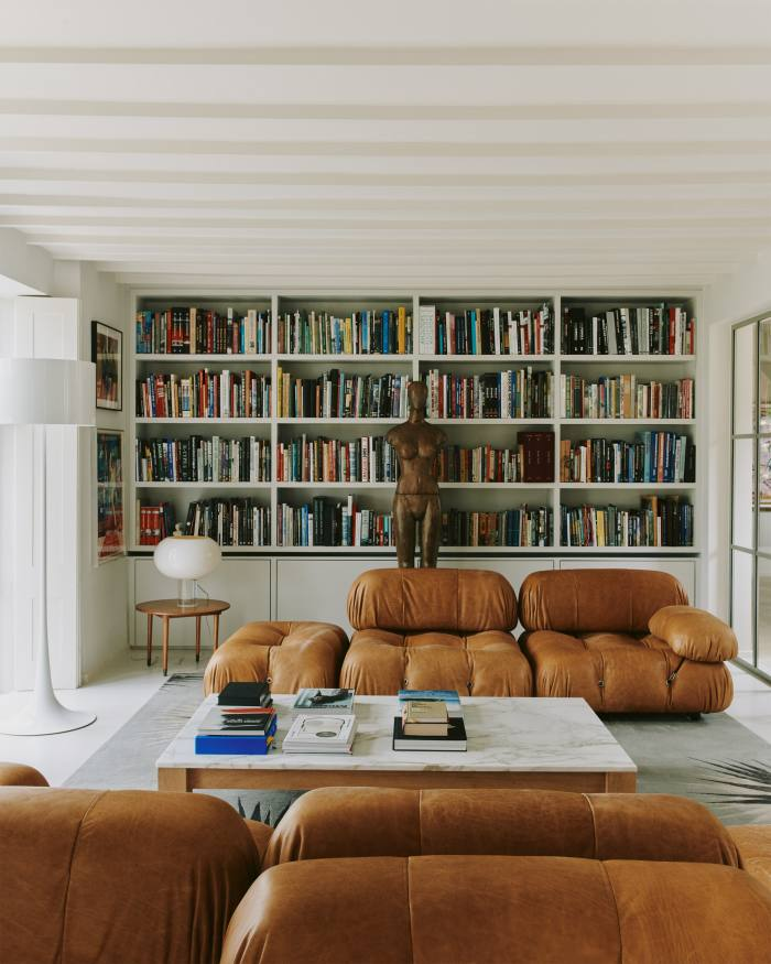 A 1970s modular sofa by Mario Bellini and a Victorian hand-carved wooden mannequin