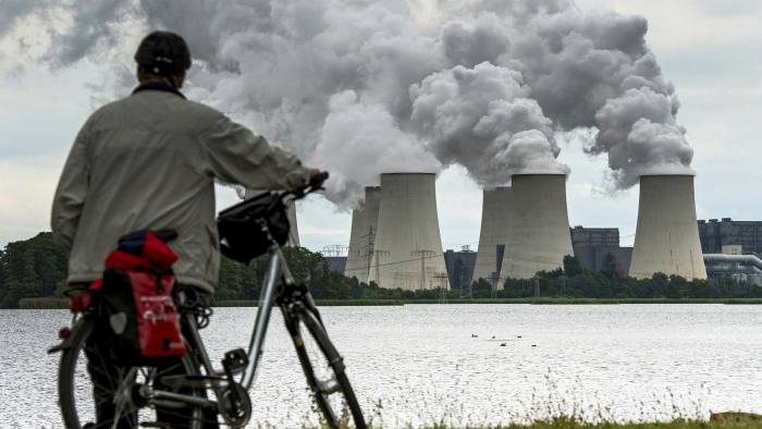 Water steam rises from the cooling towers of a brown coal power station operated by Vattenfall AG inJaenschwalde