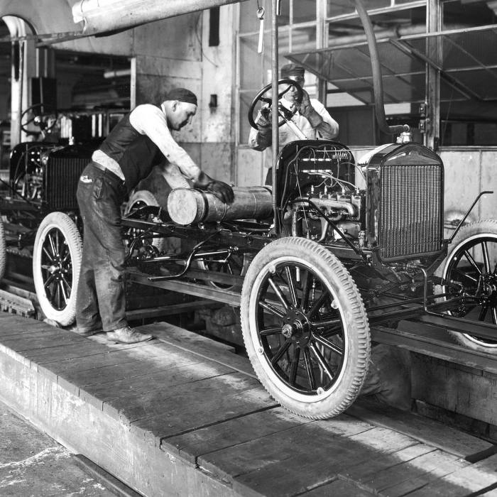 Ford's Model T car assembly line at the Highland Park plant, Michigan, 1913. The production process revolutionised the auto industry