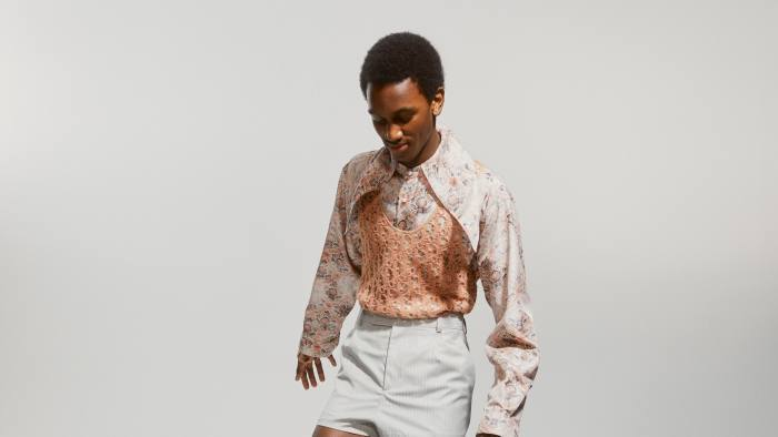 JAIDEN WATSON wears DIOR silk shirt, £1,000, tulle tank top, £1,700, wool shorts, £550, suede boots, £1,000, and cotton socks, £210