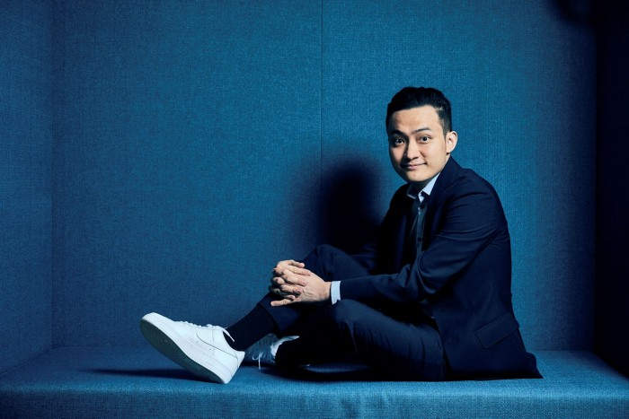 Justin Sun, founder of blockchain platform Tron, poses for a photograph