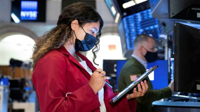 In this photo provided by the New York Stock Exchange, trader Ashley Lara works on the floor