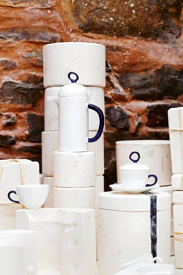 From left: Feldspar fine-bone-china double-espresso cup (part of set), £68, cafetière, £140, and lidded double-espresso cup and saucer, £68 (all seen on the moulds used to make them)