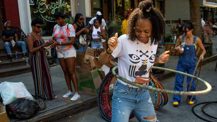 Frantically normal: hula hoopers at a block party in Brooklyn, New York, which cancelled most Covid restrictions in late June